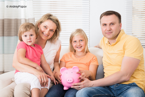 Family Saving Money In Piggybank